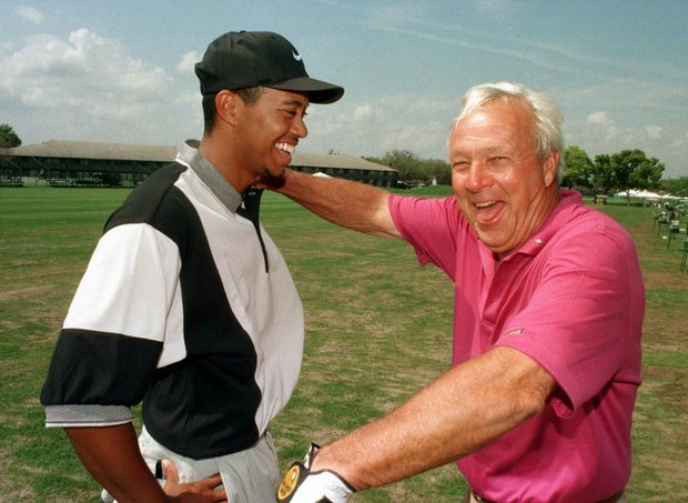 Tiger Woods and Arnold Palmer share a light moment at Bay Hill in March 1997.  (AP Photo/Golf Channel, Joe Skipper)