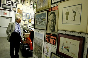 Doc Giffin, Arnold Palmer's longtime assistant, in the warehouse that holds a variety of Palmer memorabilia.