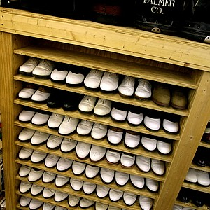 Arnold Palmer has a few shelves of his golf shoes he wore in tournaments.