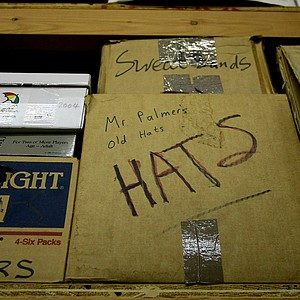 Boxes of Arnold Palmer's hats from over the years sit on shelves.