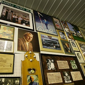 The walls of Arnold Palmer's warehouse in Latrobe, Pa., are covered with a variety of memorabilia from pictures of events and even family photos.