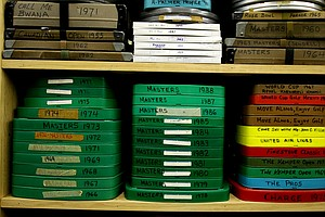 A section of shelves are lined with old film of Arnold Palmer, from golf events, to movies and instructional pieces.