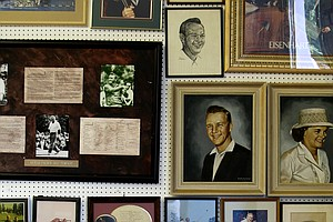 A variety of memorabilia lines the walls and floors of the warehouse.