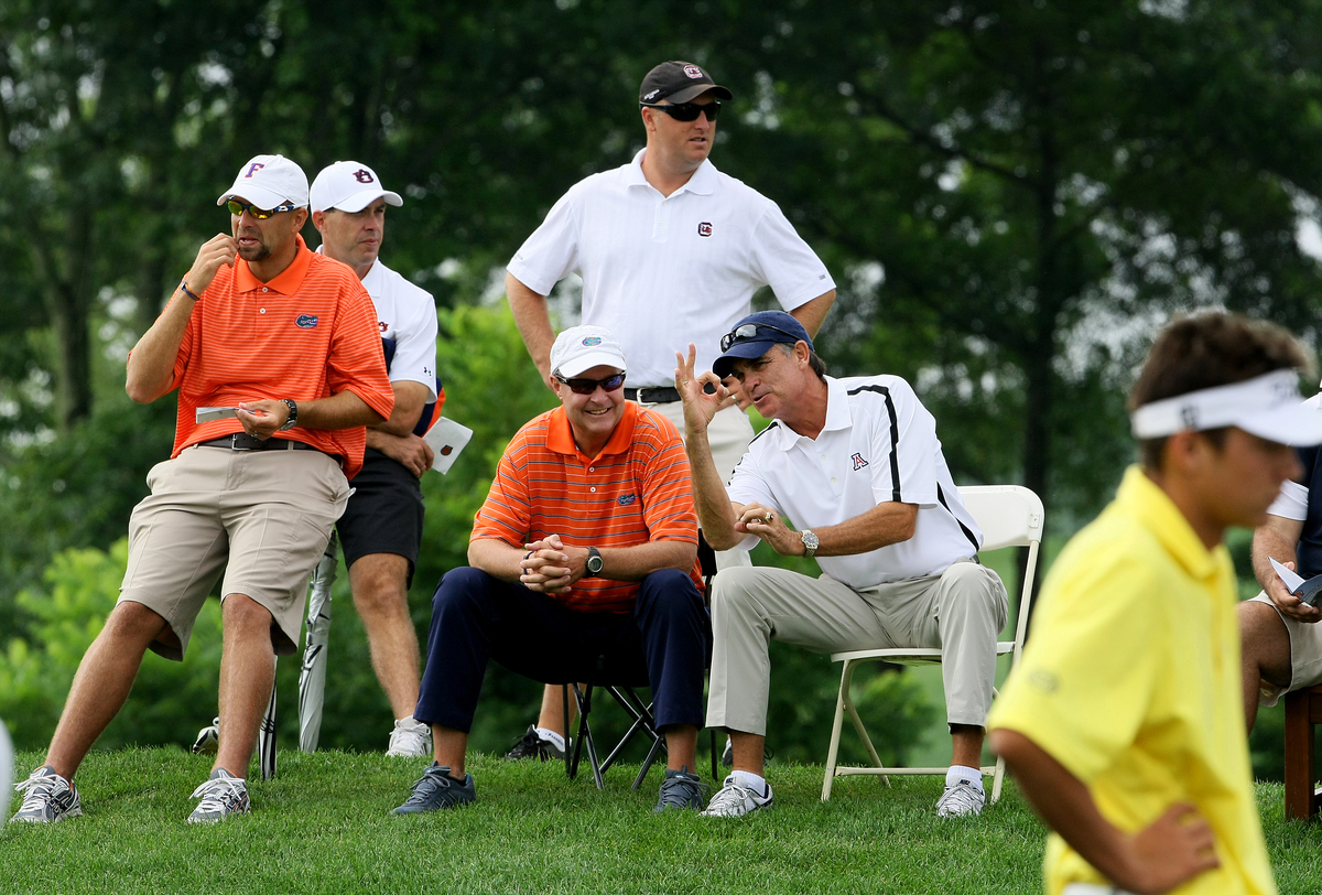 Coaches from Florida, Auburn, Alabama and South Carolina gather on the first tee at the U.S. Junior.