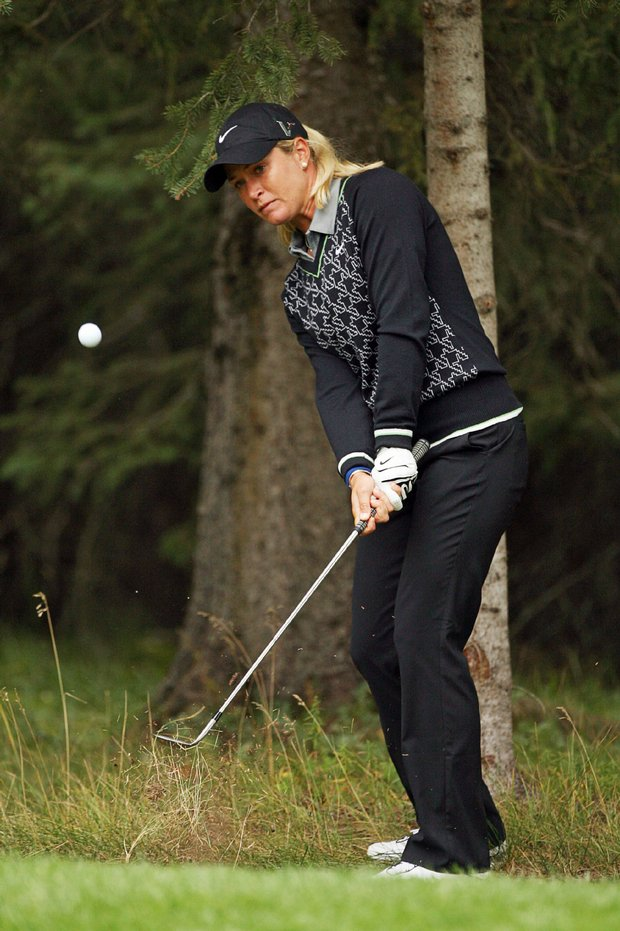Suzann Pettersen hits out of the woods on the eighth hole during the final round of the Canadian Women's Open.