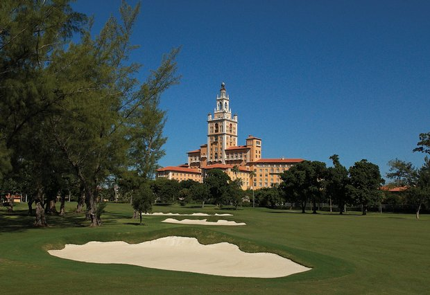 The Biltmore hotel rises majestically over Donald Ross' renovated 1925 course as refurbished bunkers line the 18th.