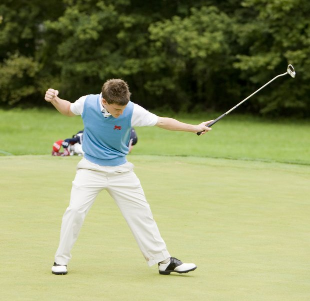 Chris Paisley (GB&I) reacts after making his birdie putt on the 12th hole during the Saturday singles round.