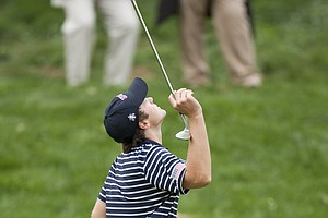 Brendan Gielow (USA) reacts after his chip barely misses the hole on the 17th hole during the Saturday singles.