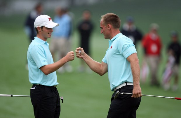 Sam Hutsby of England and Wallace Booth of Scotland celebrate a win at the 5th hole.