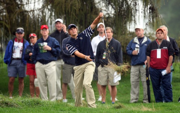 Peter Uihlein of the USA sprays a lot of hay as he plays his third shot at the 1st hole during the morning foursome matches.