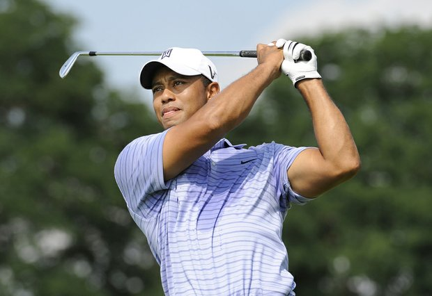 Tiger Woods hits from tee eighth tee box on his way to a third-round 62 at the BMW Championship.