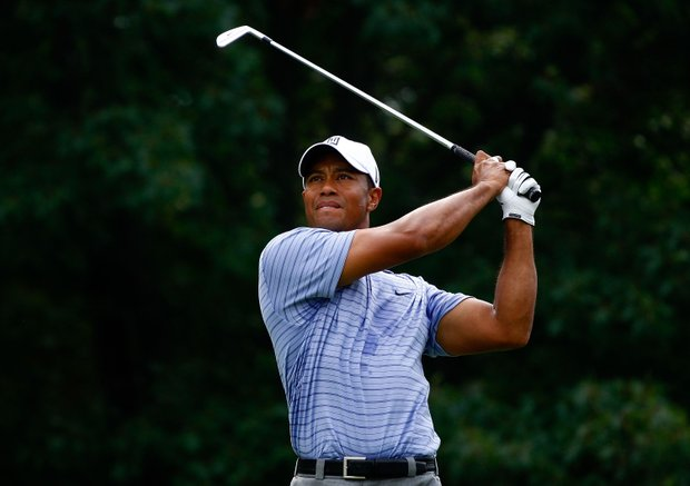 Tiger Woods shot a course-record 62 in the third round of the BMW Championship and opened up a 7-shot lead.