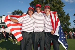 Rickie Fowler, Peter Uihlein and Morgan Hoffman of the USA celebrate on the 18th green after the USA had secured victory.
