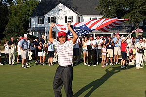 Rickie Fowler of the USA celebrates on the 18th green after the USA team had secured victory.