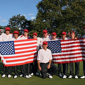 Buddy Marucci (kneeling) the captain of the USA team with his team on the 18th green after securing victory during the final afternoon singles matches.