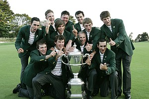 Members of the USA team gesture as they pose with golf's Walker Cup during the trophy presentation Sunday, Sept. 13, 2009.