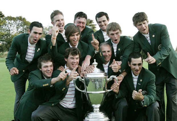 Members of Team USA celebrate with the Walker Cup.