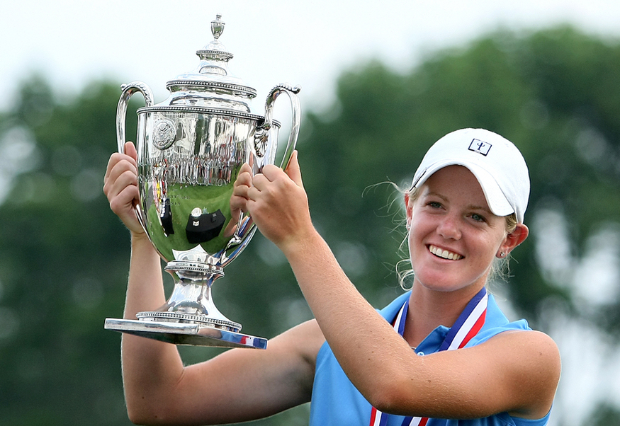 Amy Anderson hoists the U.S. Girls' Junior trophy.