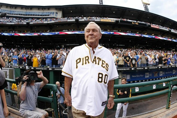Arnold Palmer arrives on the field at Pittsburgh's PNC Park to throw out the first pitch before a baseball game between the Pittsburgh Pirates and Chicago Cubs on Sept. 8, 2009.