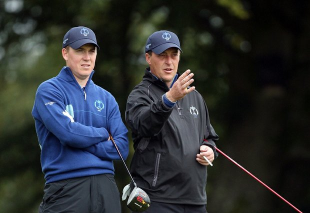 Will Barnes (left) and his partner Jon Bevan, both of England, talk at the 11th hole during the morning foursome matches Saturday at the PGA Cup.