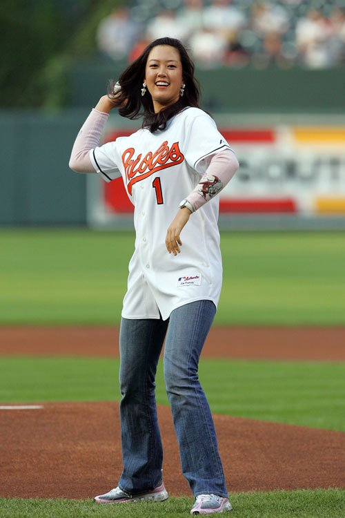Michelle Wie throws out the first pitch prior to Toronto Blue Jays vs. Baltimore Orioles game on June 6, 2006, at Camden Yards in Baltimore.