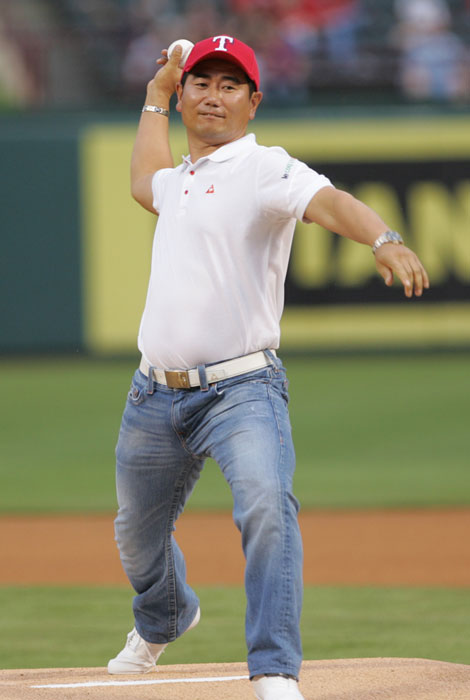 Y.E. Yang throws out the first pitch at the Los Angeles Angels vs Texas Rangers game in Arlington, Texas, on Friday Sept. 18, 2009. The Angels won 4-0.