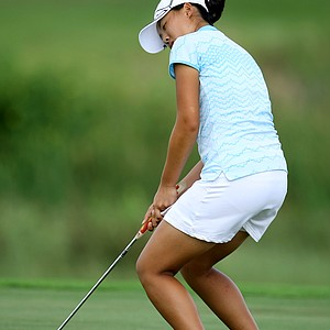 Yingzhou Yun reacts to missing a putt.