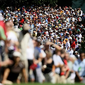 Spectators line the fairway at No. 2 during the final round of the Tour Championship.