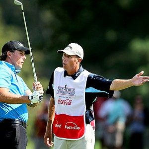 Jim 'Bones' Mackay talks with Phil Mickelson at No. 7 fairway.