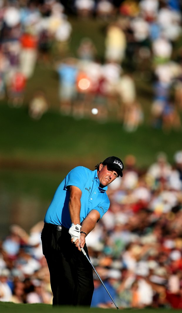 Phil MIckelson chips up at No. 18.