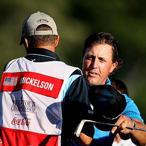 Jim 'Bones' Mackay and Phil Mickelson on 18th green.
