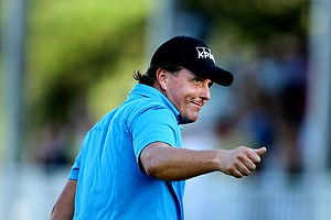 Phil Mickelson walks off the 18th green after winning The Tour Championship.