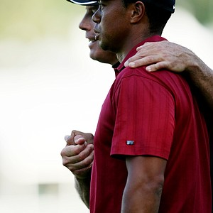 Tiger Woods and his caddie Steve Williams on the 18th green after The Tour Championship.