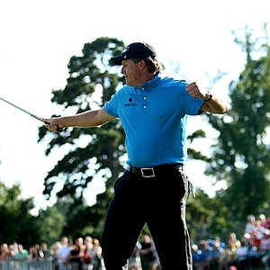 Phil Mickelson celebrates his chip in at No. 16.