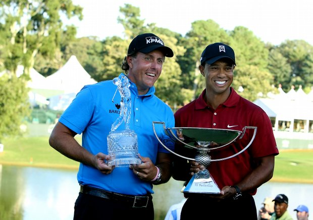 Phil Mickelson, left, winner of the Tour Championship and Tiger Woods, right, winner of the Fed Ex Cup, pose at East Lake Country Club.