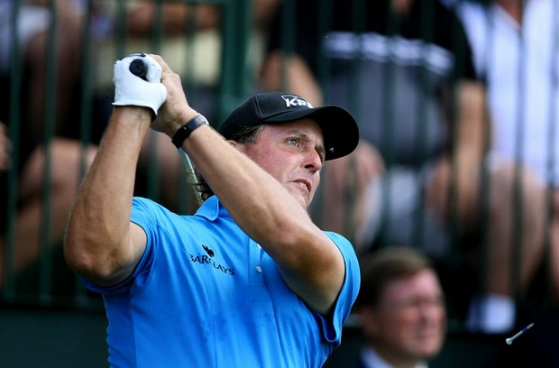 Phil Mickelson hits his tee shot at No. 1 during the final round of the Tour Championship.