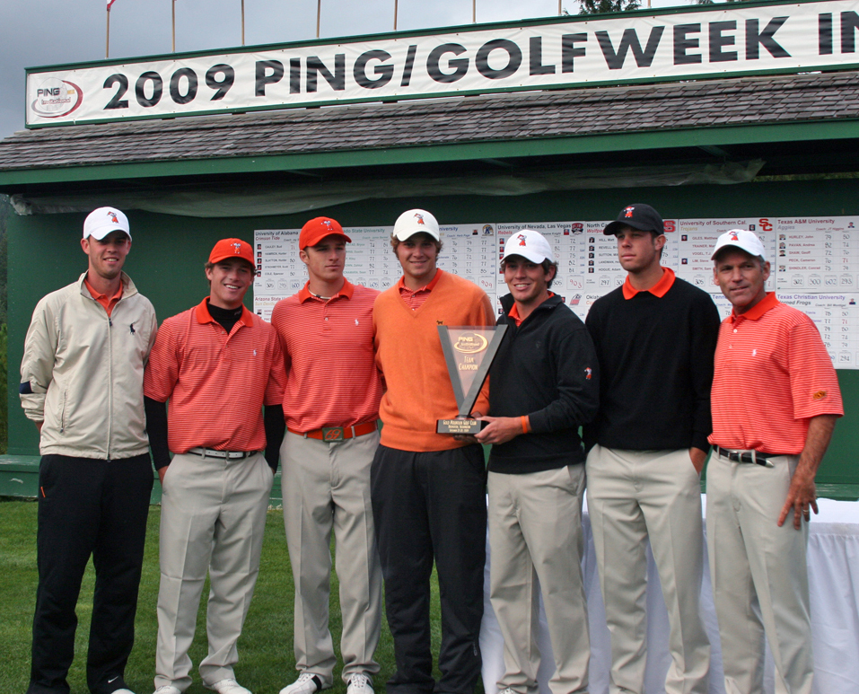 Oklahoma State poses with the championship trophy.