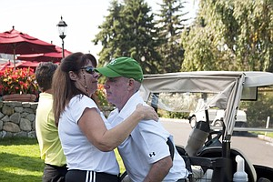 Ken Green, right, embraces his sister Shelly White at a charity golf tournament at Ridgewood Coutry Club. Contributions can be made to the Ken Green Trust. For more information, visit www.kengreenscomeback.com.