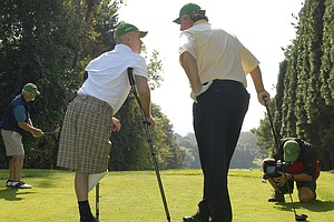 Ken Green, left,  talks with Andy Bean at a charity golf tournament at the Ridgewood Country Club.