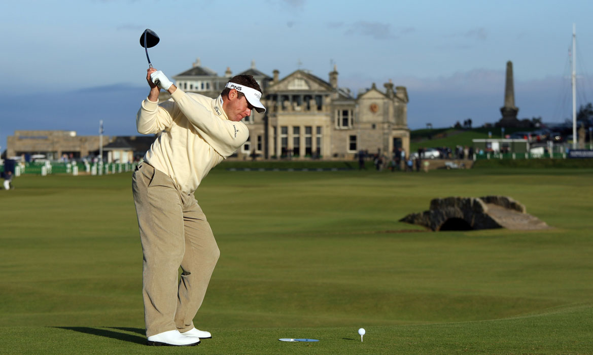 Lee Westwood tees off from the 18th tee during a practice round at the Old Course at St. Andrews.