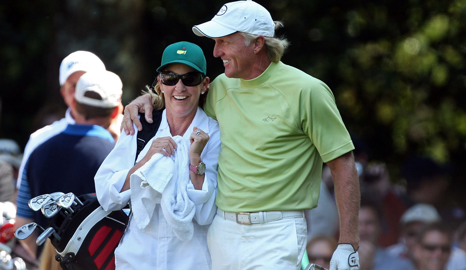 Chris Evert caddies for Greg Norman during the par 3 contest prior to the Masters in April.