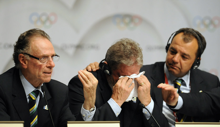 Brazilian President Luiz Inacio Lula da Silva cries beside President of Rio 2016 Bid Committee Carlos Arthur Nuzman (left) and Governor of the State of Rio de Janeiro Sergio Cabral (right) at the press conference after Rio won the right to host the 2016 Olympic games.
