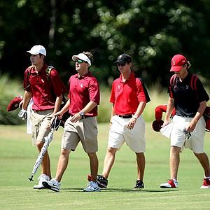 Florida State player Michael Hebert, far left, and Texas Tech's Brian Scherer, far right, with coaches.
