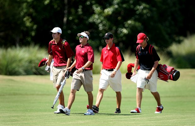 Florida State player Michael Hebert, far left, and Texas Tech's Brian Scherer, far right, with coaches.
