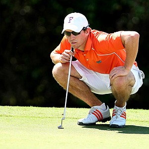Florida's Andres Echavarria looks over his putt at No. 15.