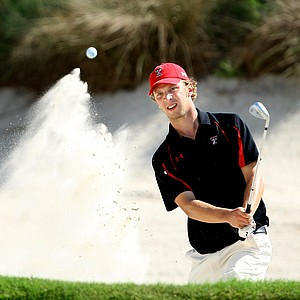 Nils Floren of Texas Tech hits out of a greenside bunker at No. 18.