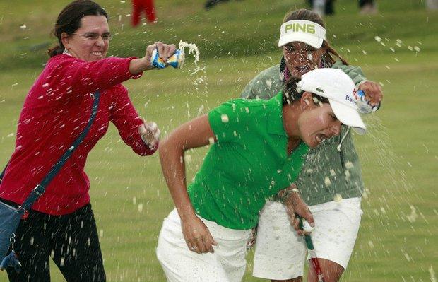 Lorena Ochoa gets doused by friends after winning the Navistar LPGA Classic Oct. 4.