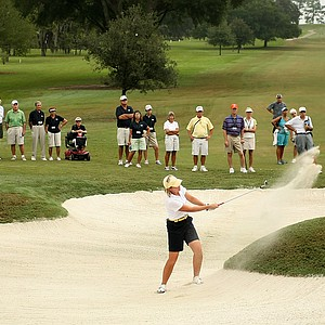 Martha Leach hits out of the bunker at No. 4. Leach and Laura Coble halved the hole with 6.