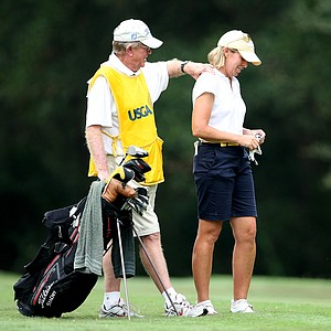 Martha Leach's caddie/husband, John, gives Leach a shoulder massage at No. 13.