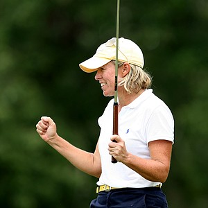 Martha Leach celebrates winning the 23rd U.S. Women's Mid-Amateur Championship at Golden Hills Golf & Turf Club.